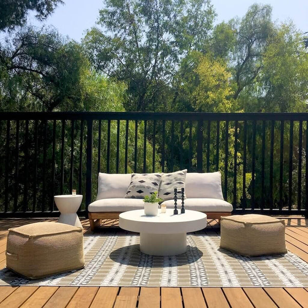 Moroccan Mad Mat on a wood deck with modern outdoor furniture.