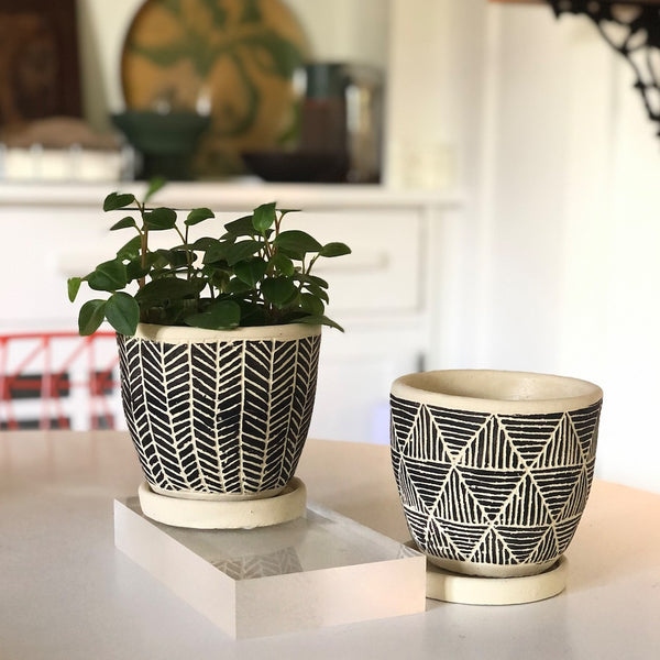 Two White Clay planters with tribal black motif in triangles and herringbone.