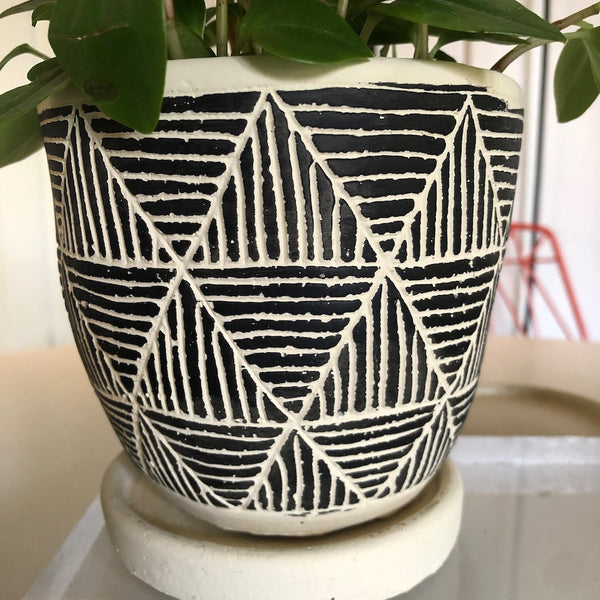White Clay planter with tribal black motif in triangles.