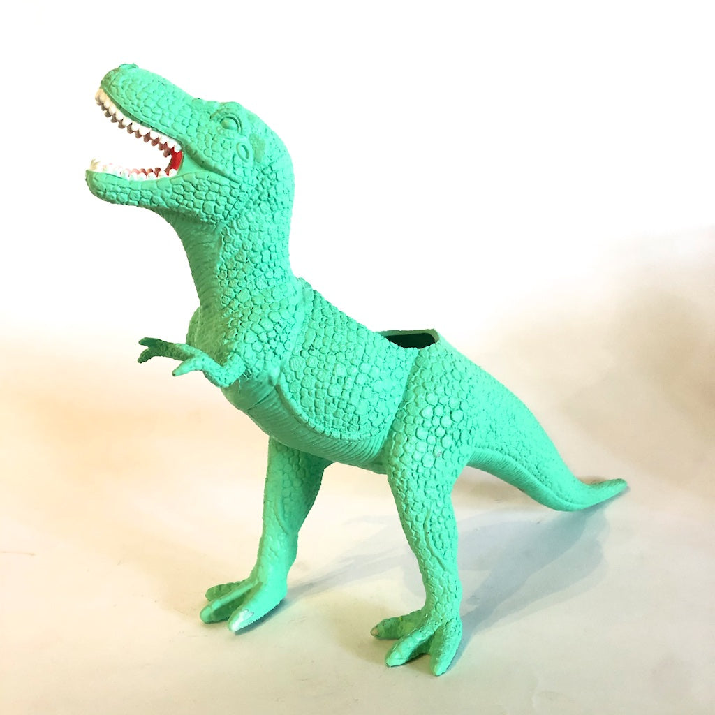 A T. Tex dinosaur planter in green.