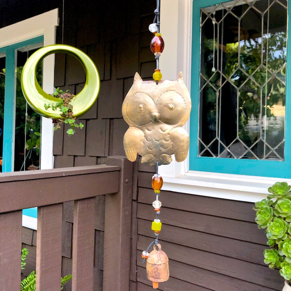 Owl shaped brass and glass bead garden mobile.