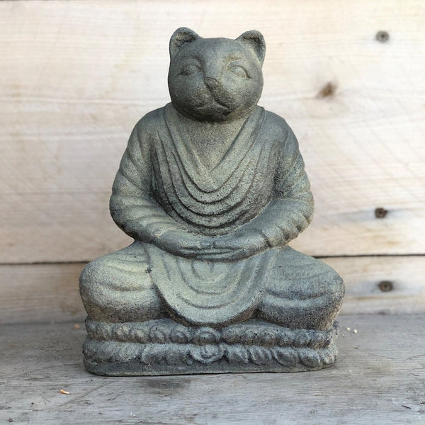 Meditating cat cast stone garden statue.