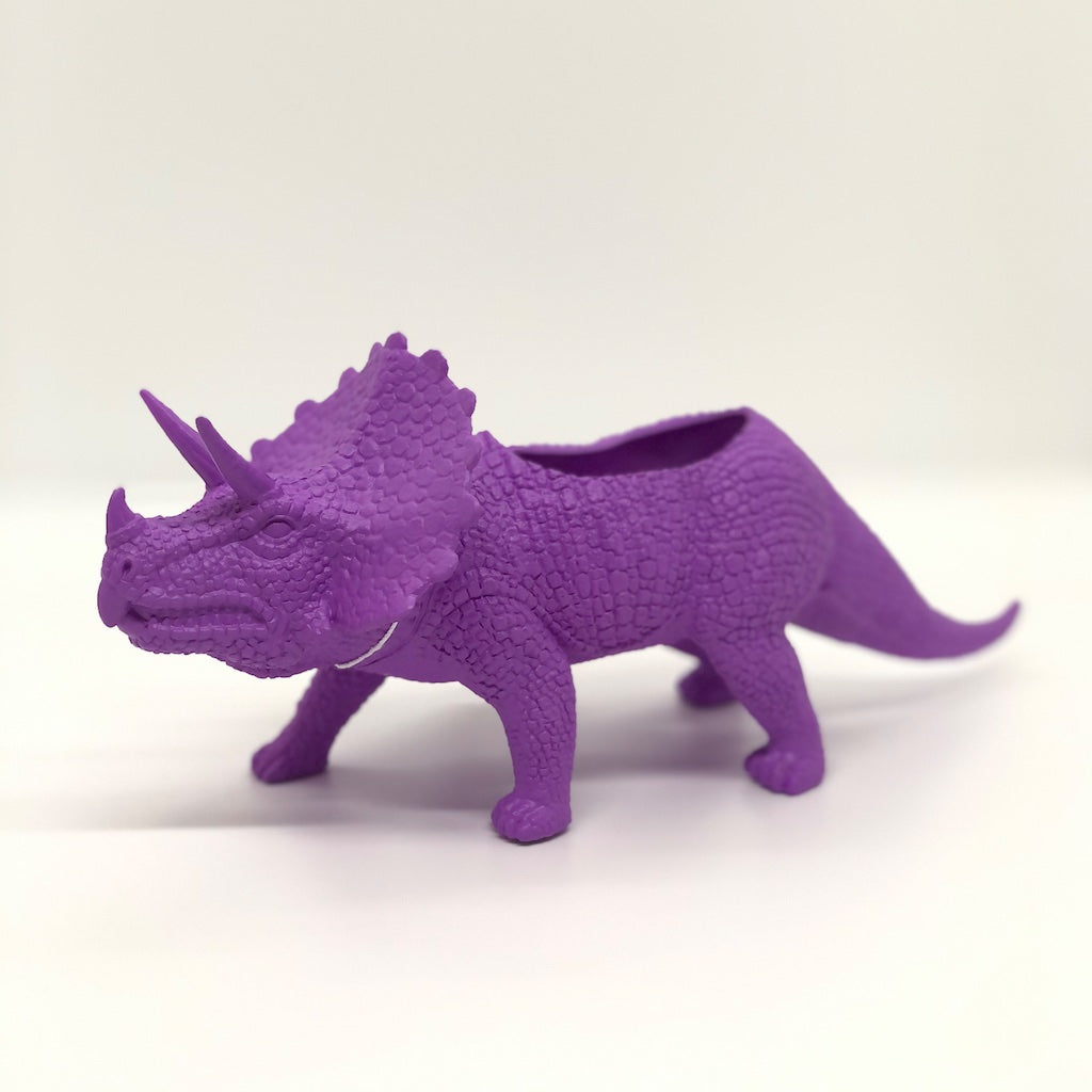 Triceratops dinosaur planter in purple.
