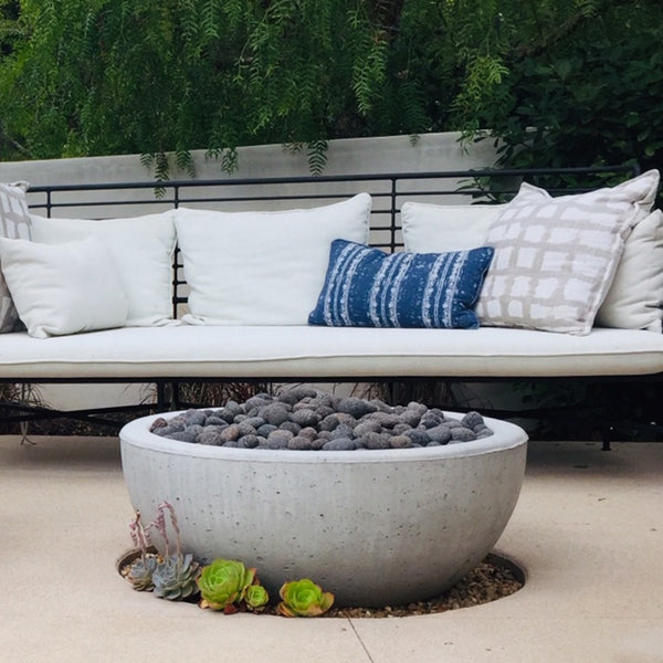 Bowl concrete fire pit in a garden designed by King Garden Design.