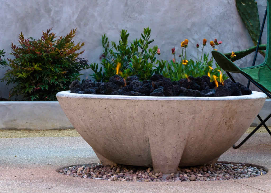 Close shot of a Cazo fire pit (a fire pit with three concrete legs).