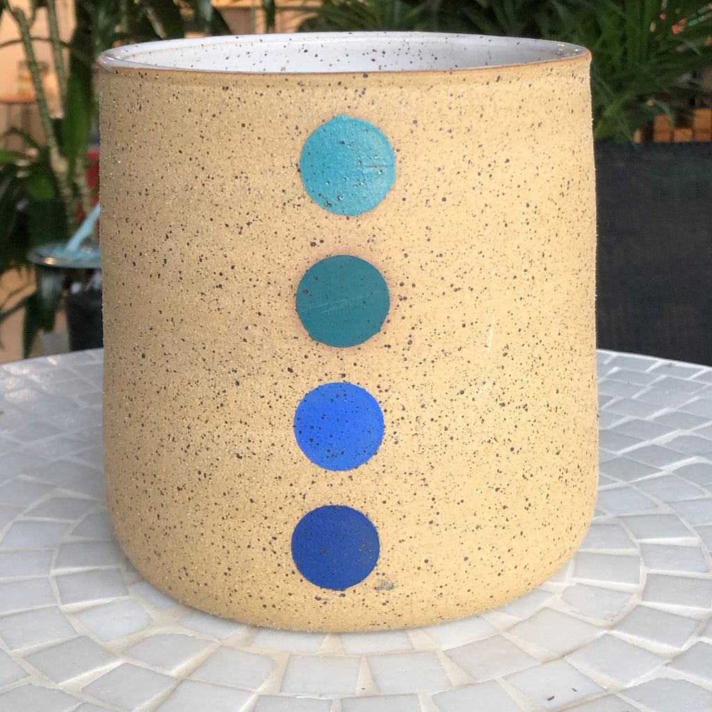 Double M Pottery planters with four dots in blues.