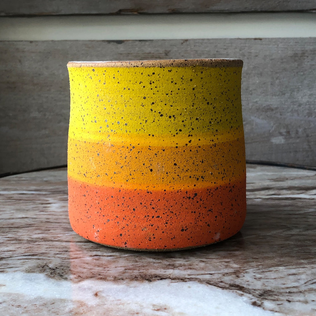 Double M Pottery with wide stripes in multi colors.