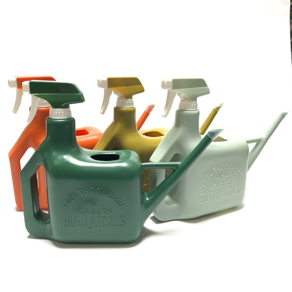 Watering can with spray bottle in various colors.