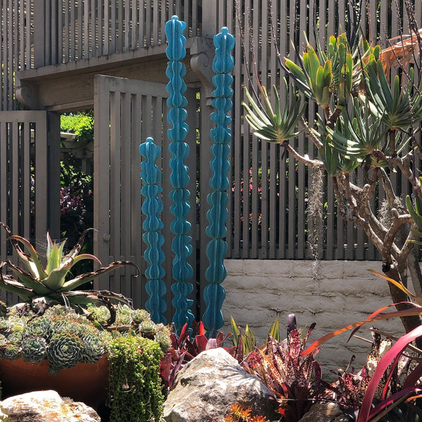 Garden art cactus trio by Dustin Gimbel in turquoise.