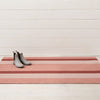 Peach multi stripe outdoor Chilewich mat.