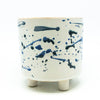 White Footed Cylinder with Blue Splatter Design