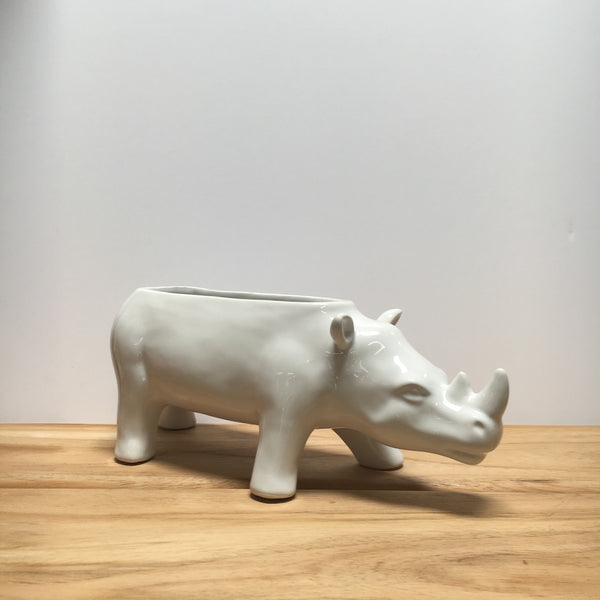 Empty white rhino planter.