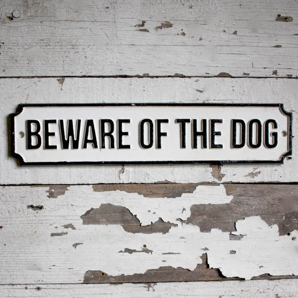 Before of the Dog Sign black letters with a white background.