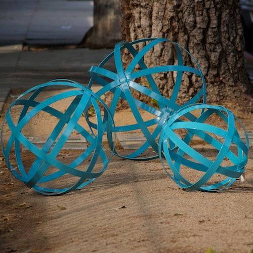 "Set of three iron spheres powder coated turquoise and used as garden art in 30"", 24"" and 18"" size."