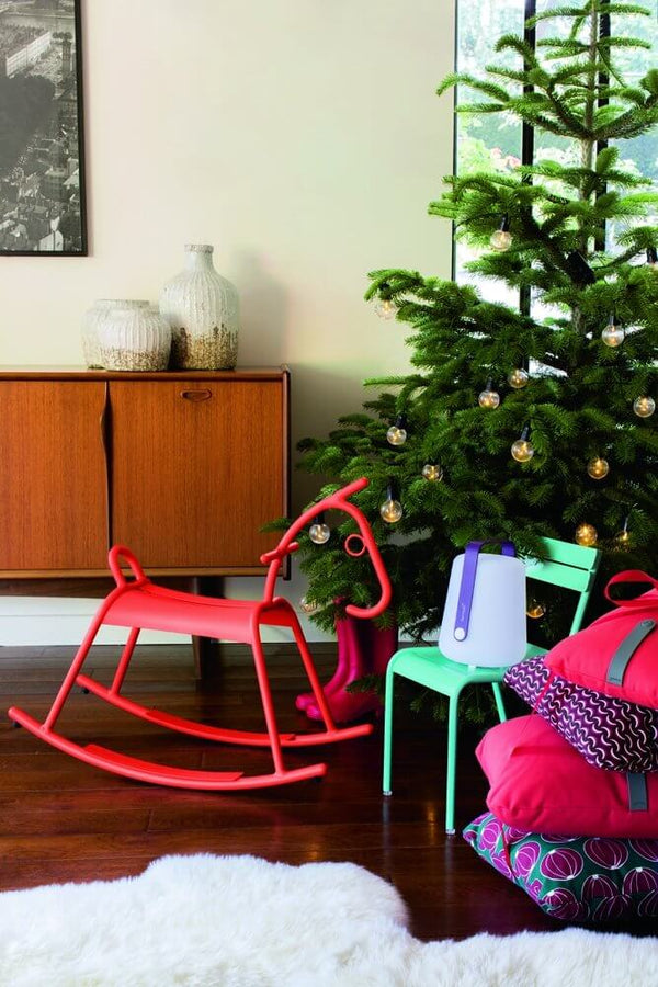 Fermob Adada Rocking horse by a Christmas Tree.