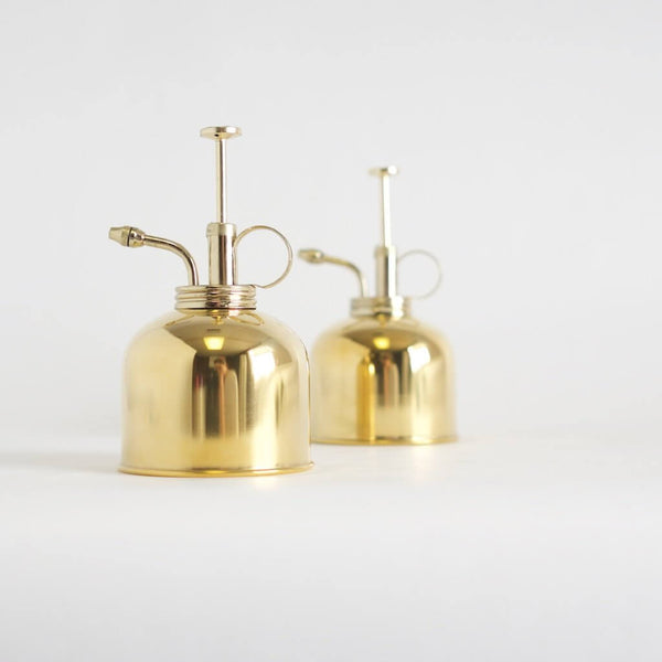 Two brass plant misters.