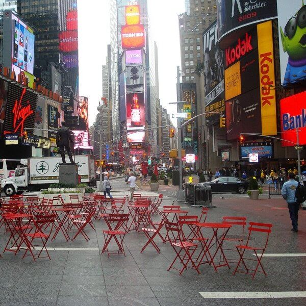 Red bistro chairs and tables in Time Square.