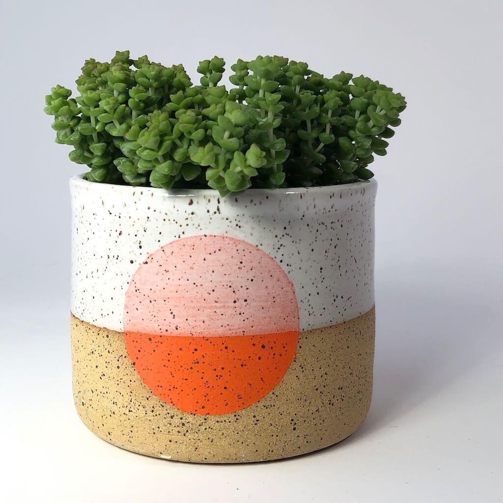 Doulbe M handmade pot with orange dot.