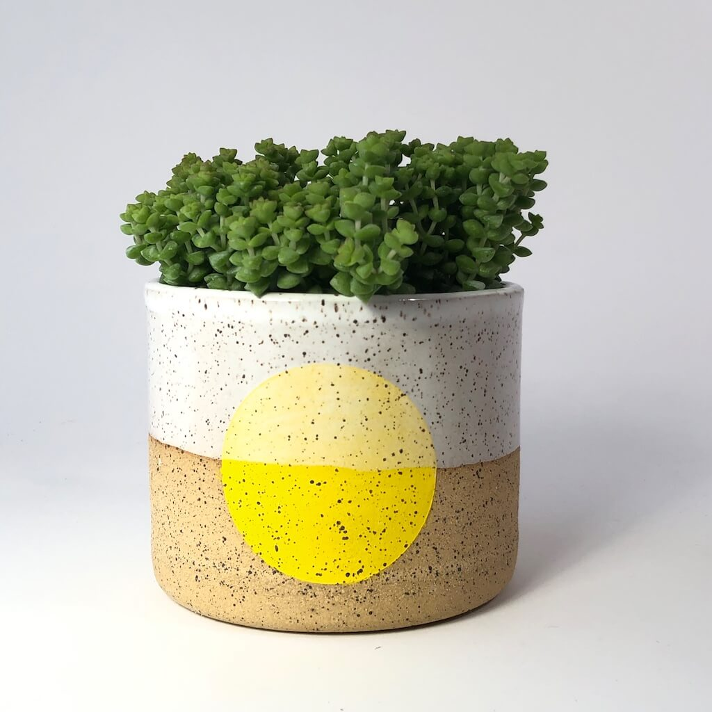 Doulbe M handmade pot with yellow dot.