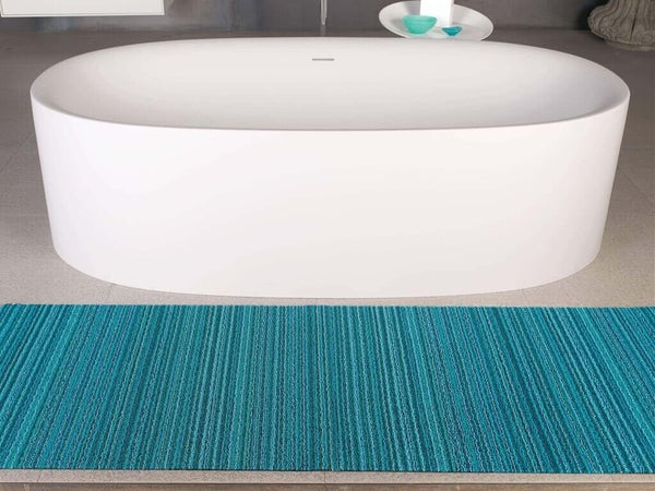 Turquoise skinny stripe Chilewich outdoor mats.