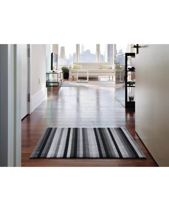 Chilewich shag mat in mineral even stripe by front door.