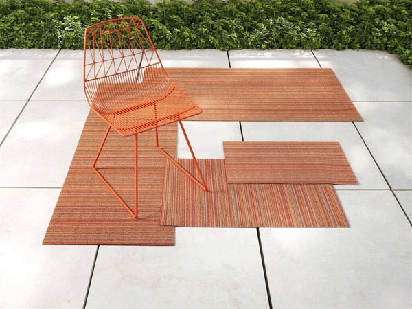 Orange skinny stripe Chilewich outdoor mats.