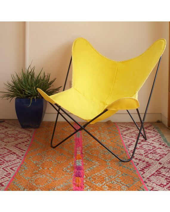 Yellow canvas butterfly chair cover on black frame.