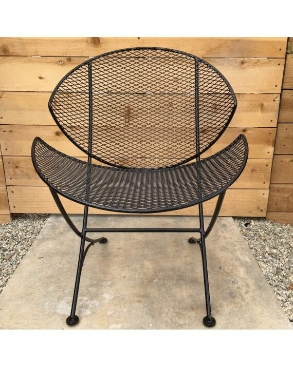 Front-view shot of metal mesh clam chair in black.
