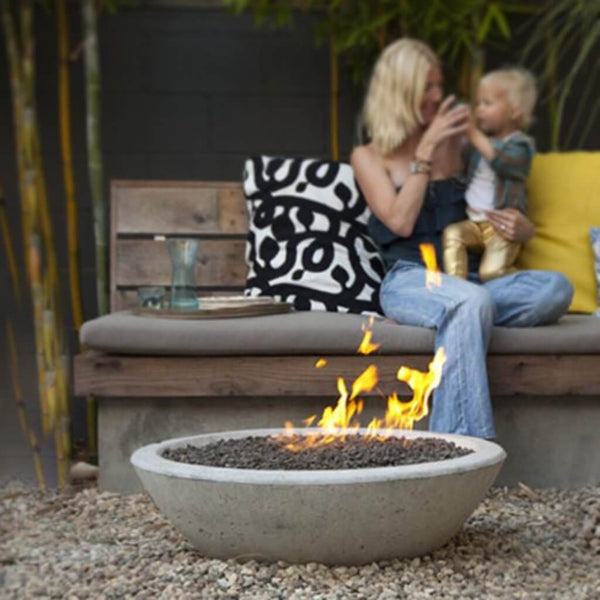 Wok fire pit in a gravel garden. Designed by Steve Siegrist.