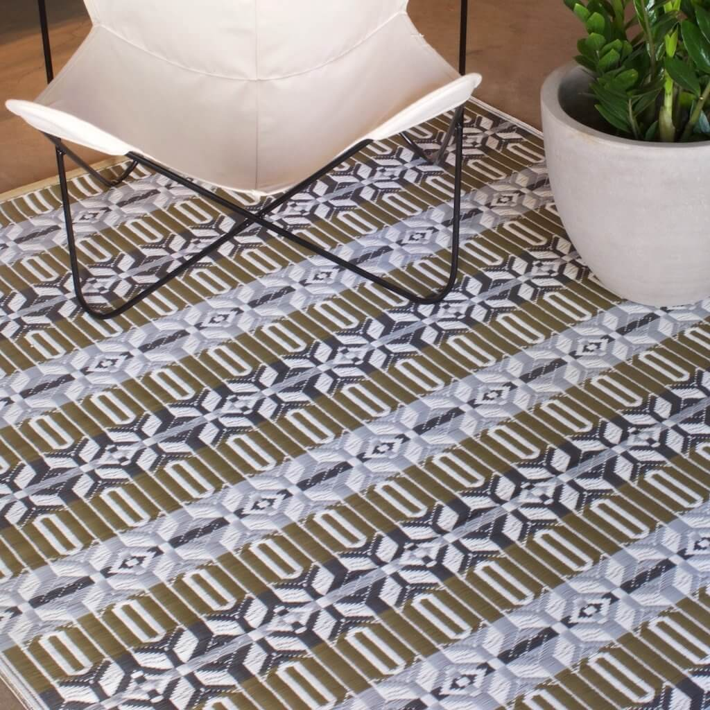 Moroccan Mad Mat in cool silver color with a white Butterfly Chair on top.