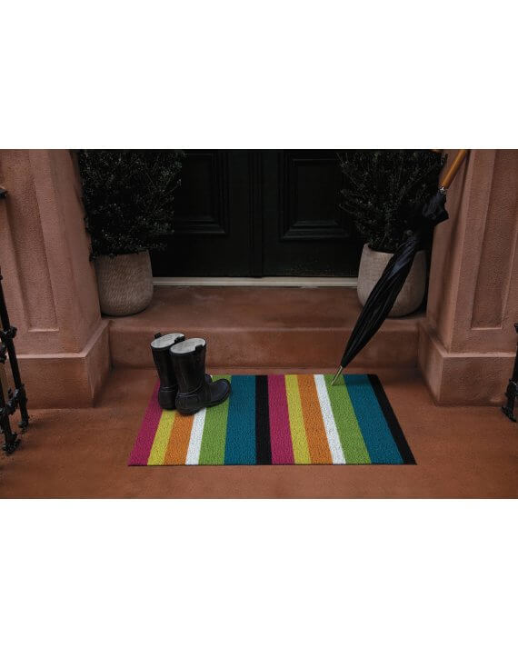 Bold multi stripe outdoor Chilewich mat by a front door.