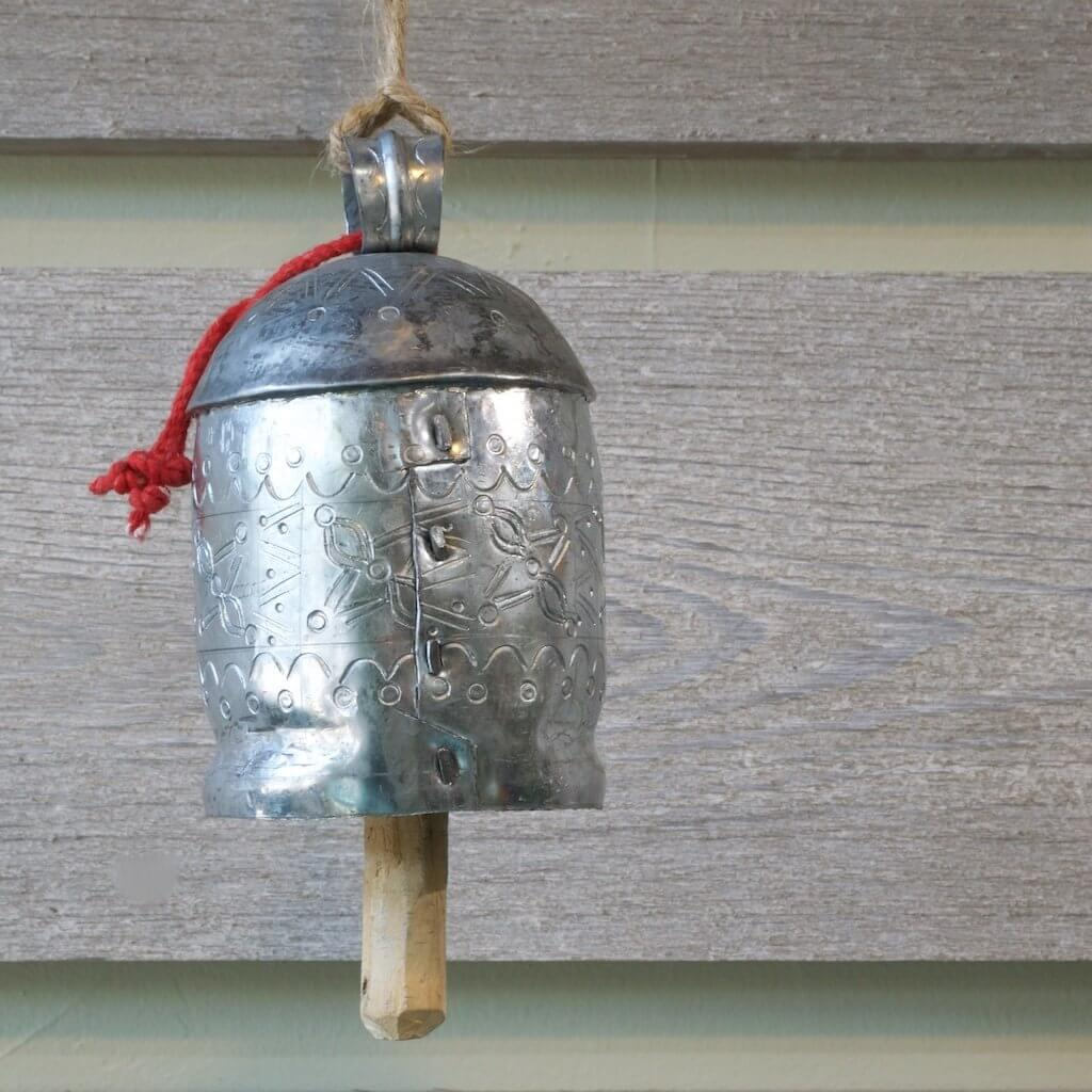 Nickled silver cow bell made in india.