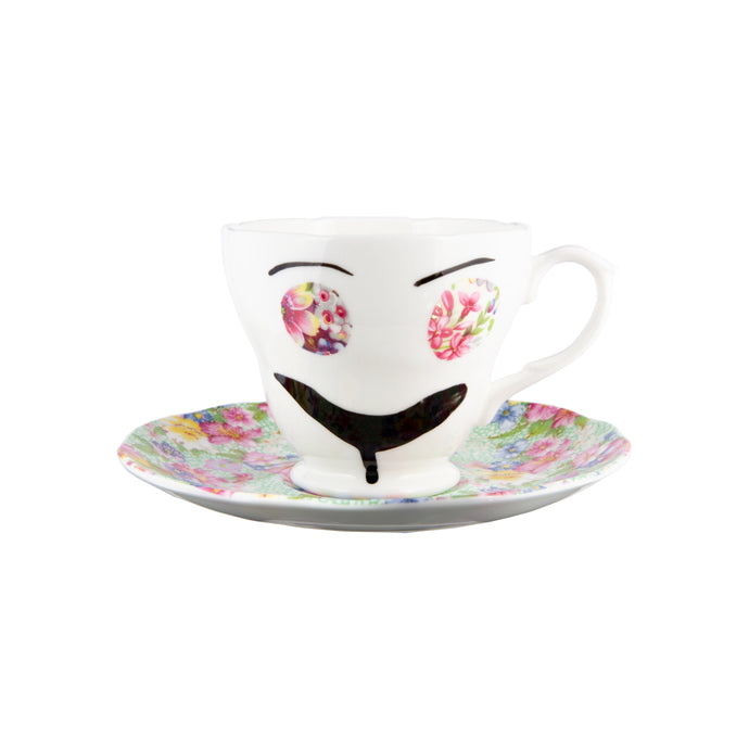Teacup and matching saucer