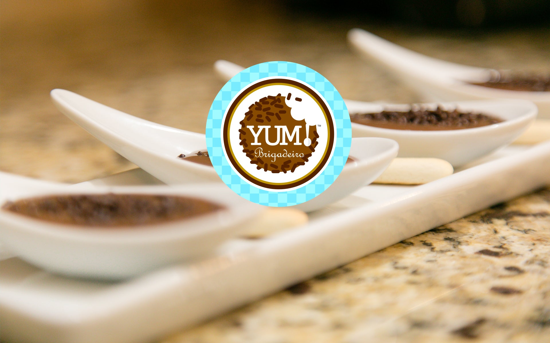 Yum Brigadeiro on a serving spoon and logo