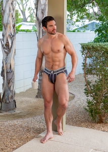 Steve Grand wearing GRAND AXIS brief underwear in charcoal