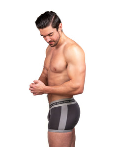 Steve Grand wearing GRAND AXIS boxerbrief underwear. charcoal color. side view