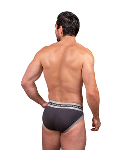 Steve Grand wearing GRAND AXIS brief underwear in charcoal back view