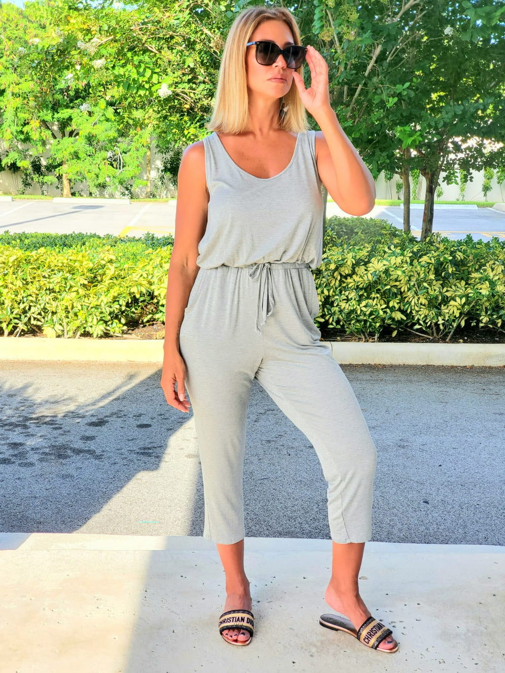 Loose fit, scoop V-neck, sleeveless jumpsuit.