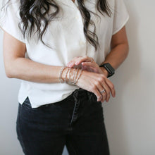 Load image into Gallery viewer, Woman wearing a stack of Morse Code Bracelets