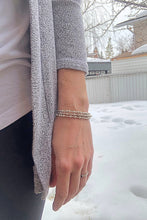 Load image into Gallery viewer, Women wearing three silver Morse Code Bracelets