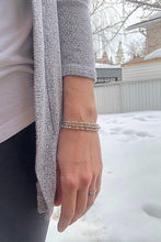Load image into Gallery viewer, Woman wearing three silver Morse Code Bracelets in the winter