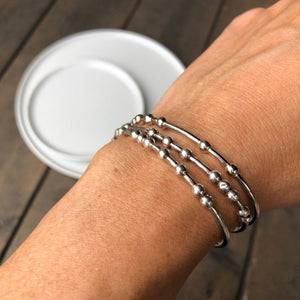 Women wearing three Morse Code Bracelets