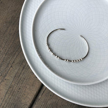 Load image into Gallery viewer, Silver CARPE DIEM Morse Code Bracelet on a plate