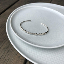 Load image into Gallery viewer, Sterling silver CARPE DIEM Morse Code Bangle on a plate