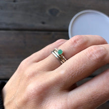 Load image into Gallery viewer, Wearing a Emerald Ring and two silver bands