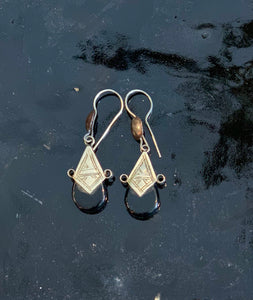 black glass earrings with traditional Moroccan etchings