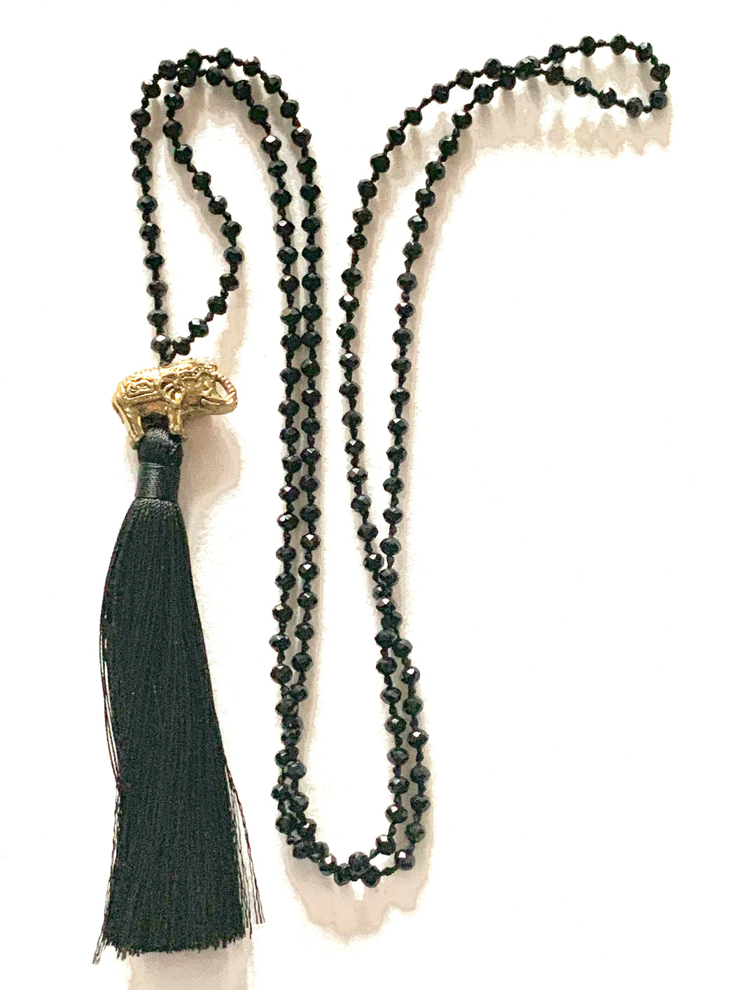 black beaded tasselled necklace