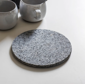 round trivet made from granite 20 x 20 cm