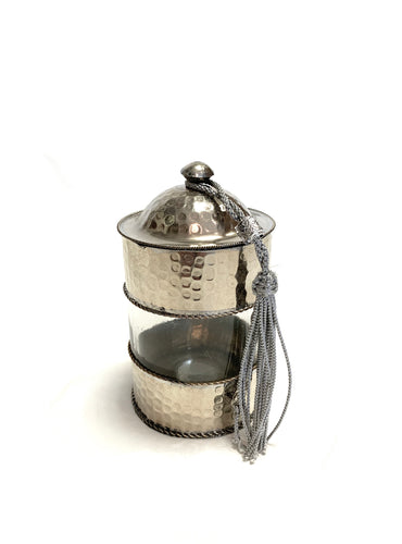 Small handcrafted Moroccan storage pot with beaten metal lid
