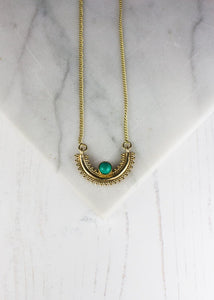 Turquoise stone in a semi circle necklace